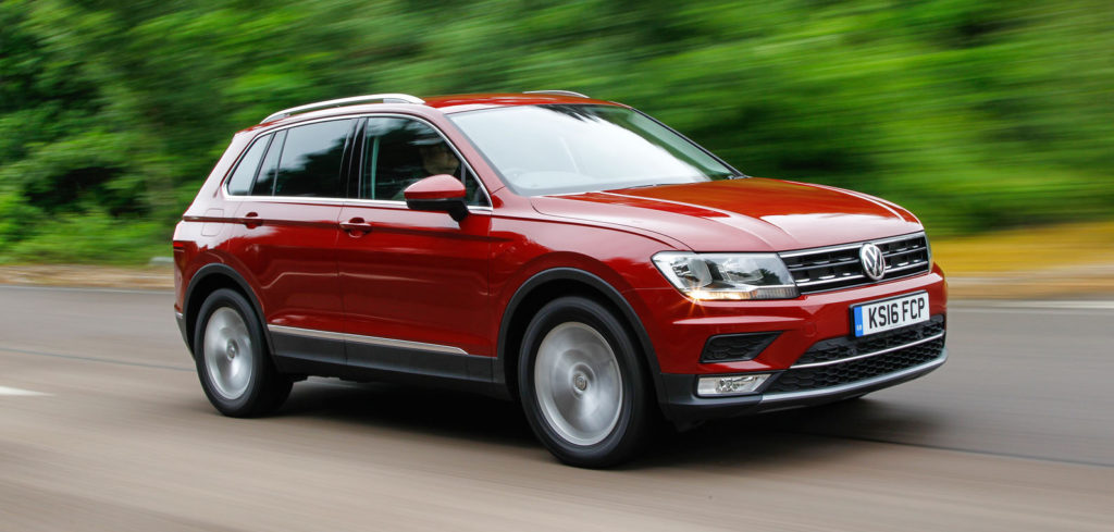 VW Tiguan driving on road